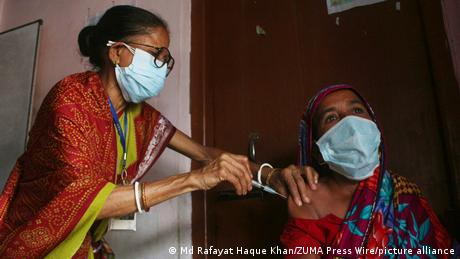 A woman in Bangladesh gets a COVID-19 vaccination