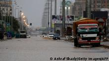 Cars drive along a flooded street in Khartoum after torrential rain fell on the Sudanese capital, almost paralising traffic, on August 8, 2021. - Flashfloods due to heavy rains swept through Sudan today, overwhelming the country's already poor drainage systems, and reportedly destroying hundreds of homes in other parts. (Photo by ASHRAF SHAZLY / AFP) (Photo by ASHRAF SHAZLY/AFP via Getty Images)