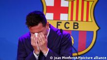 Lionel Messi cries at the start of a press conference at the Camp Nou stadium in Barcelona, Spain, Sunday, Aug. 8, 2021. FC Barcelona had previously announced the negotiations with Lionel Messi had ended and that Messi would be leaving the club. (AP Photo/Joan Monfort)