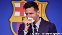 TOPSHOT - Barcelona's Argentinian forward Lionel Messi cries at the start of a press conference at the Camp Nou stadium in Barcelona on August 8, 2021. - The six-time Ballon d'Or winner Messi had been expected to sign a new five-year deal with Barcelona on August 5 but instead, after 788 games, the club announced he is leaving at the age of 34. (Photo by Pau BARRENA / AFP) (Photo by PAU BARRENA/AFP via Getty Images)