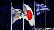 Tokyo 2020 Olympics - The Tokyo 2020 Olympics Closing Ceremony - Olympic Stadium, Tokyo, Japan - August 8, 2021. The Olympic, Japanese and Greek flags are pictured REUTERS/Carlos Barria