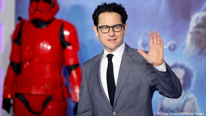 J.J. Abrams waves to the camera at the European premiere of 'The Rise of Skywalker'