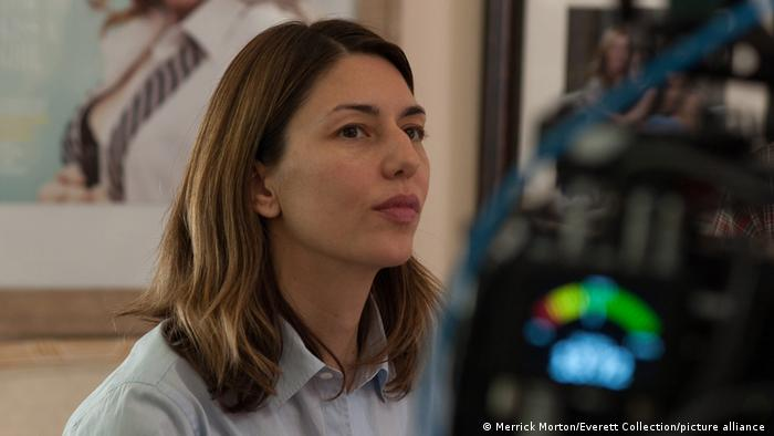 Profile shot of director Sophia Coppola, with a camera in the foreground