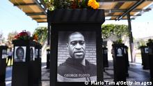 SAN DIEGO, CALIFORNIA - JULY 20: A photograph of George Floyd (C) is displayed along with other photographs at the Say Their Names memorial exhibit at Martin Luther King Jr. Promenade on July 20, 2021 in San Diego, California. The traveling memorial features photographs of 200 Black Americans who lost their lives due to systemic racism and racial injustice and is sponsored by the San Diego African American Museum of Fine Art (SDAAMFA). Former Minneapolis police officer Derek Chauvin was sentenced to 22 years and six months in prison after being convicted of murder in the death of George Floyd. (Photo by Mario Tama/Getty Images)