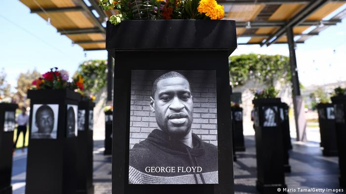 A photograph of George Floyd is displayed along with other photographs at the Say Their Names memorial exhibit in San Diego, California
