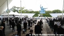 Attendees offer silent prayers during a memorial service for victims of the US atomic bombing at the Nagasaki Peace Park in Nagasaki on August 9, 2021, as the city marks the 76th anniversary of the bombing. - - Japan OUT (Photo by STR / JIJI PRESS / AFP) / Japan OUT (Photo by STR/JIJI PRESS/AFP via Getty Images)