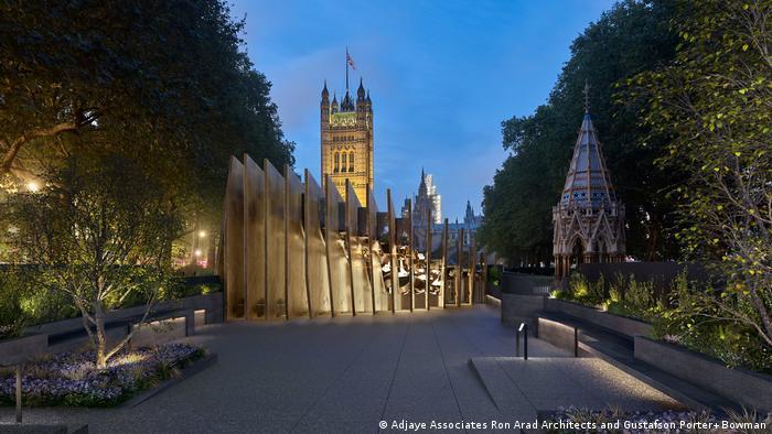 Foto mostra projeto do memorial. Trata-se de uma construção em uma praça.