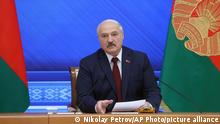 Belarusian President Alexander Lukashenko speaks during an annual press conference in Minsk, Belarus, Monday, Aug. 9, 2021. Belarus' authoritarian leader on Monday charged that the opposition was plotting a coup in the runup to last year's presidential election that triggered a monthslong wave of mass protests. President Alexander Lukashenko held his annual press conference on Monday, the one-year anniversary of the vote that handed him a sixth term in office but was denounced by the opposition and the West as rigged. (Nikolay Petrov/BelTA photo via AP)