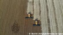 Aerial view of combine harvesters being used to harvest soybeans in a field at Salto do Jacui, in Rio Grande do Sul, Brazil, on April 5, 2021. - Rio Grande do Sul is the third-largest state producer of grain in the country, which is the world's largest producer of soy. According to the Ministry of Agriculture, production should reach a new record, estimated at 135.5 million tons, approximately 8.6% more tons than the 2019/20 harvest. (Photo by SILVIO AVILA / AFP) (Photo by SILVIO AVILA/AFP via Getty Images)