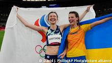 Mariya Lasitskene, left, of the Russian Olympic Committee, celebrates after winning the gold medal in the women's high jump final with bronze medalist Yaroslava Mahuchikh, of Ukraine, at the 2020 Summer Olympics, Saturday, Aug. 7, 2021, in Tokyo. (AP Photo/David J. Phillip)