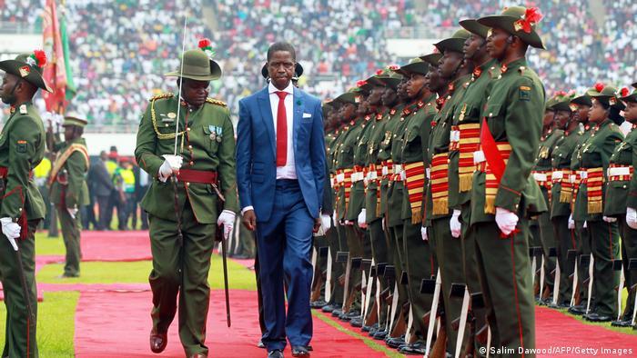 Zambian President Edgar Lungu reviews a guard of honor