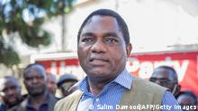 Hakainde Hichilema, leader of the United Party for National Development (UPND), addresses supporters after being questioned at Lusaka Police Force headquarters in Lusaka, Zambia, on December 23, 2020. - Two demonstrators were killed on December 23, 2020 in a protest outside the police headquarters in the Zambian capital Lusaka, where opposition leader Hakainde Hichilema was being questioned. (Photo by SALIM DAWOOD / AFP) (Photo by SALIM DAWOOD/AFP via Getty Images)