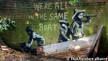 Street art which has appeared on a wall in Nicholas Everitt Park, which is believed to be a new work by street artist Banksy, in Lowestoft, England, Saturday, Aug. 7, 2021. (PA via AP)