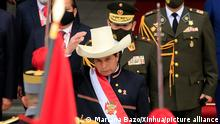 (210729) -- LIMA, July 29, 2021 (Xinhua) -- Pedro Castillo inspects a guard of honor after being sworn in as president of Peru in Lima, Peru, July 28, 2021. Pedro Castillo was sworn in on Wednesday as president of Peru during a ceremony in the nation's Congress in Lima, after weeks of uncertainty following defeating a right-wing rival in a hard-fought presidential runoff. (Photo by Mariana Bazo/Xinhua)