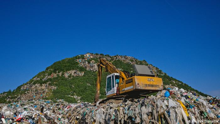 An excavator sits at the Pata Rat landfill in Cluj, Romania