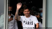 Lionel Messi waves after arriving at Le Bourget airport, north of Paris, Tuesday, Aug. 10, 2021. Lionel Messi finalized agreement on his Paris Saint-Germain contract and was flying to France on Tuesday to complete the move that confirms the end of a career-long association with Barcelona. (AP Photo/Francois Mori)