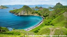 Palau Padar with ohm shaped beach with green hills in Komodo National Park, Flores, Indonesia