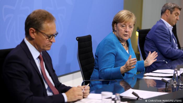 Berlin Mayor Michael Müller with Chancellor Angela Merkel