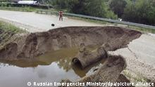 AMUR REGION, RUSSIA - AUGUST 10, 2021: A washed out road in the flood-hit Mazanovsky District. As of August 8, 2021, the total of 183 residential buildings have been flooded in the town of Belogorsk, in Bureisky, Seryshevsky, Selemdzhinsky, and Arkharinsky Districts of Russia's Far Eastern Amur Region. 1,450 homesteads are flooded, roads are cut off in 25 localities. Video screen grab. Russia Emergencies Ministry/TASS