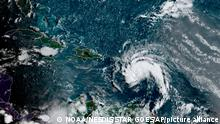 This satellite image provided by the National Oceanic and Atmospheric Administration (NOAA) shows a tropical storm east of Puerto Rico in the Caribbean, at 7:50am EST, Tuesday, Aug. 10, 2021. The National Hurricane Center issued tropical storm warnings for the U.S. Virgin Islands and Puerto Rico, where forecasters expected the potential cyclone to strengthen Tuesday into the sixth named storm, Fred, of the Atlantic hurricane season. (NOAA/NESDIS/STAR GOES via AP)