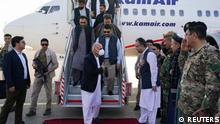 Afghanistan president Ashraf Ghani arrives in Mazar-i-Sharif to check the security situation of the northern provinces, Afghanistan August 11, 2021. Afghan presidential palace/Handout via REUTERS NO RESALES. NO ARCHIVES. THIS IMAGE HAS BEEN SUPPLIED BY A THIRD PARTY. THIS PICTURE WAS PROCESSED BY REUTERS TO ENHANCE QUALITY. AN UNPROCESSED VERSION HAS BEEN PROVIDED SEPARATELY.