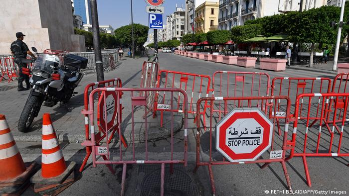 Tunisian police barricade the main street in Tunis during the political crisis