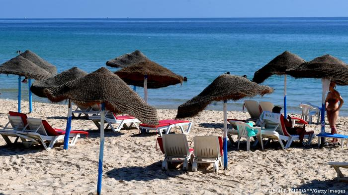 Tourists relax at a hotel beach in Tunisia's coastal city of Sousse