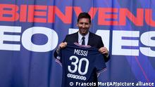 Lionel Messi holds his jersey after a press conference Wednesday, Aug. 11, 2021 at the Parc des Princes stadium in Paris. Lionel Messi said he's been enjoying his time in Paris since the first minute after he signed his Paris Saint-Germain contract on Tuesday night. The 34-year-old Argentina star signed a two-year deal with the option for a third season after leaving Barcelona. (AP Photo/Francois Mori)