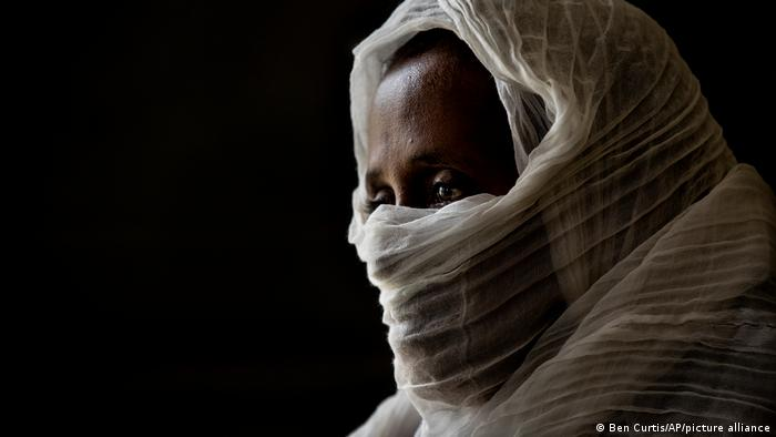 A woman who was says she was held captive and repeatedly raped by Eritrean soldiers in a remote village near the Eritrea border, speaks at a hospital in Mekele, Tigray