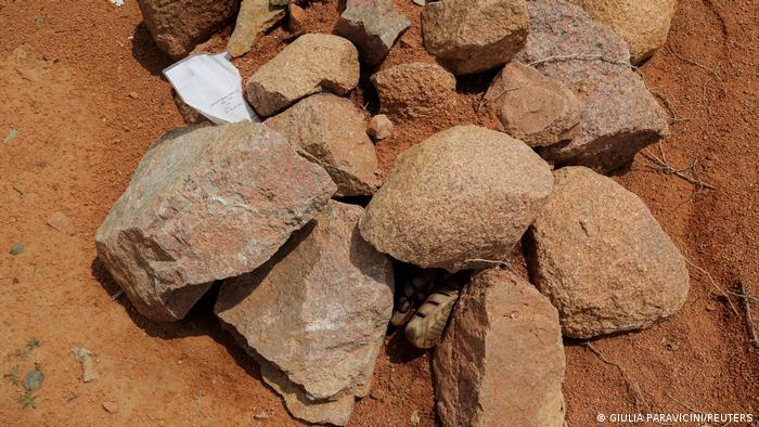 Stones are arranged on a grave where a piece of paper says a soldier from Ethiopia's military is buried in the outskirts of Yechila in Tigray, Ethiopia, July 10, 2021