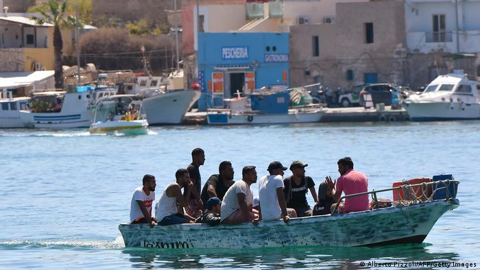 Migrants arrive on a boat in the Italian island of Lampedusa on July 29, 2020.