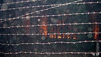 An approaching forest fire seen through the barbed wire fence of Russia's top nuclear facility, Sarov