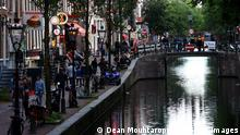 AMSTERDAM, NETHERLANDS - JULY 01: A general view of the Red Light District as it reopens after the Coronavirus or Covid19 Lockdown on July 01, 2020 in Amsterdam, Netherlands. Prime Minister of the Netherlands Mark Rutte announced that sex workers could officially return to work from July 1 but with strict rules about face-to-face contact, hygiene and making clients check for symptoms. (Photo by Dean Mouhtaropoulos/Getty Images)