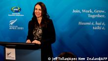 This handout picture taken and released on July 17, 2021 by APEC New Zealand shows New Zealand's Prime Minister Jacinda Ardern speaking at a press conference after the APEC Informal Leaders' Retreat at the Majestic Centre in Wellington. (Photo by JEFF TOLLAN / APEC NEW ZEALAND / AFP) / --- RESTRICTED TO EDITORIAL USE - MANDATORY CREDIT AFP PHOTO /APEC NEW ZEALAND/ JEFF TOLLAN - NO MARKETING NO ADVERTISING CAMPAIGNS - DISTRIBUTED AS A SERVICE TO CLIENTS