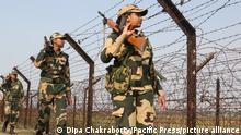 Indian Border Security Force (BSF) soldiers with dog patrolling at North 24 Pargana at the India-Bangladesh Border on the outskirts of Kolkata. (Photo by Dipa Chakraborty/Pacific Press)
