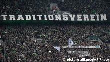 Borussia supporters show a banner reading 'tradition club' to protest against newcomer RB Leipzig during the German Bundesliga soccer match between Borussia Moenchengladbach and RB Leipzig in Moenchengladbach, Sunday, Feb. 19, 2017. (AP Photo/Martin Meissner)