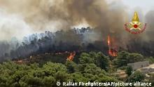 In this photo released by the Italian Firefighters, a view of a fire near Giarratana, in the province of Ragusa, Sicily, Italy, Thursday, Aug. 12, 2021, as many wildfires continue plaguing the region. Sicily, Sardinia, Calabria and also central Italy, as temperatures reached a record hight in Floridia, Sicily, were badly hit by wildfires. Climate scientists say there is little doubt that climate change from the burning of coal, oil and natural gas is driving extreme events, such as heat waves, droughts, wildfires, floods and storms. (Italian Firefighters via AP)