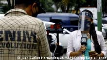 August 24, 2020, Valencia, Carabobo, Venezuela: August 24, 2020. The journalist Ruth Laverde, from the channel Venezolans for information, VPI (by its acronym in Spanish) reports for the supervision of the week of flexibilization of the Covid-19 in Venezuela. .Journalists in Venezuela have little access to official information and must go to other reliable sources of information about daily life in the Covid era. In Valencia, Carabobo state. Photo: Juan Carlos Hernandez. (Credit Image: © Juan Carlos Hernandez/ZUMA Wire