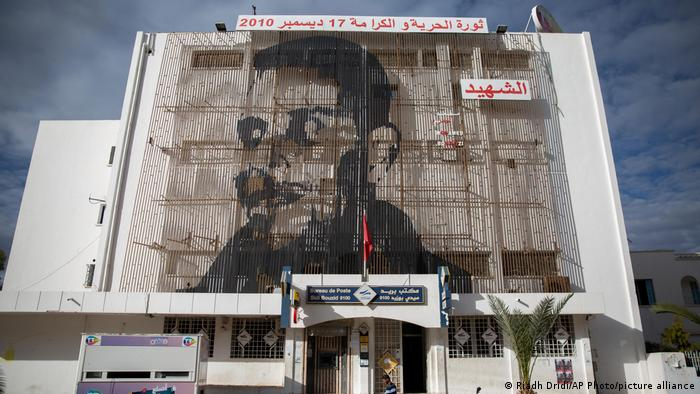 A huge picture of Mohammed Bouazizi on the facade of post office in Sidi Bouzid, Tunisia.
