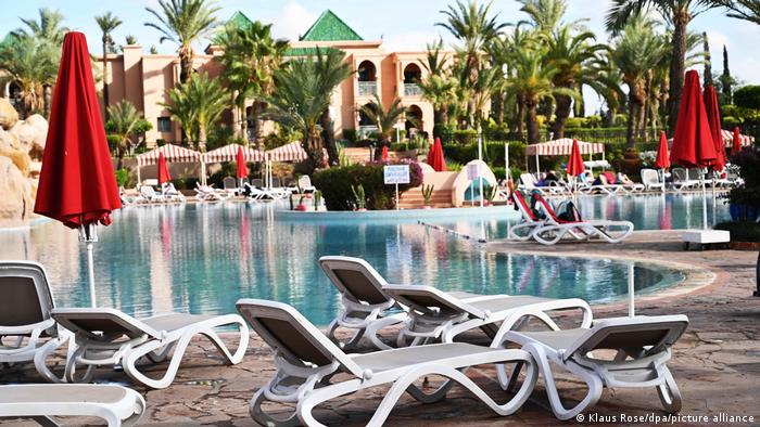 A pool and lounge chairs in Morocco.