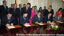 (from L to R) The leader of the Democratic Party of Albanians, Arben Dzaferi, Macedonian Prime Minister Lubco Georgievski, Macedonian President Boris Trajkovski, the leader of Social Democratic Party of Macedonia, Branko Crvenkovski and the leader ofAlbanian Prosperity Democratic Party, Imer Imery sign the peace accord in Skopje on Monday, 13 August 2001. NATO Secretary General George Robertson welcomed the accord signed Monday, 13 August 2001, between Macedonian and ethnic Albanian political parties, saying it was a major day for returning to peaceful and normal life. The peace deal, the fruit of two weeks of tough negotiations brokered by Western envoys, is seen as Macedonia's best hope of averting a civil war after a six-month ethnic Albanian rebellion in the north that radicalised the country along ethnic lines. dpa Pool +++ dpa-Bildfunk +++
