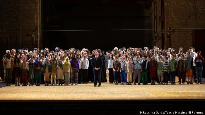 The Rainbow Choir on stage for a performance of 'Parsifal' in the Teatro Massimo