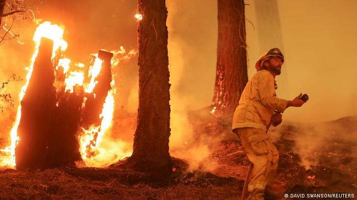 A firefighter continues to hold the line of the Dixie Fire near Taylorsville, California, United States, August 10, 2021