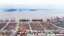 (210304) -- BEIJING, March 4, 2021 (Xinhua) -- Aerial photo taken on March 3, 2021 shows a view at the Ningbo Zhoushan Port in Ningbo, east China's Zhejiang Province. Both cargo and container throughput of Ningbo Zhoushan Port registered year-on-year growth of 4.7 percent and 4.3 percent respectively in 2020. The port saw its cargo throughput reach 1.172 billion tons while the container throughput achieved 28.72 million twenty-foot equivalent units (TEUs) last year. (Xinhua/Weng Xinyang)