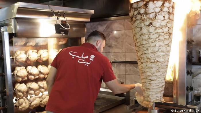 Man working in a Syrian restaurant