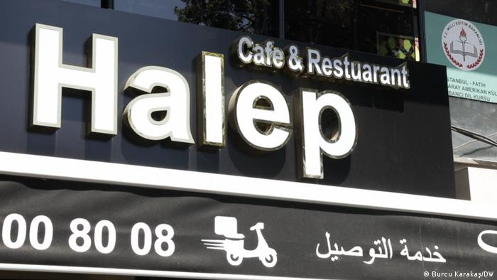 Restaurant sign with Arabic writing