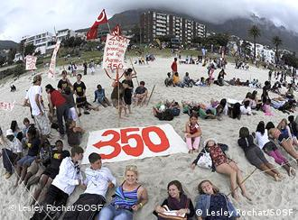 Activists crowded around a banner reading '350' at an event held as part of the 350.org International Day of Climate Action on October 24, 2009.