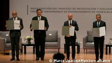 Venezuela's President of the National Assembly Jorge Rodriguez, from left, Mexico's Foreign Minister Marcelo Ebrard, Norwegian diplomat Dan Nylander and Venezuelan opposition delegate Gerardo Blyde Perez, pose for a photo in Mexico City, Friday, Aug. 13, 2021. The government of Venezuela and its opposition are set to begin a new dialogue this week looking for a change in the South American nation's prolonged political standoff. (AP Photo/Marco Ugarte)