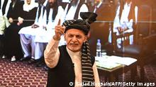 Afghanistan's President Ashraf Ghani gestures during a function at the Afghan presidential palace in Kabul on August 4, 2021. (Photo by SAJJAD HUSSAIN / AFP) (Photo by SAJJAD HUSSAIN/AFP via Getty Images)