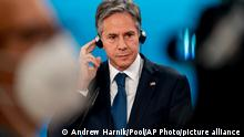 Secretary of State Antony Blinken listens to a translator during a news conference with German Minister of Foreign Affairs Heiko Maas at the Ministry of Foreign Affairs in Berlin, Wednesday, June 23, 2021. Blinken begins a week long trip in Europe traveling to Germany, France and Italy. (AP Photo/Andrew Harnik, Pool)